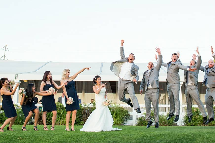 The wedding party jumping for joy