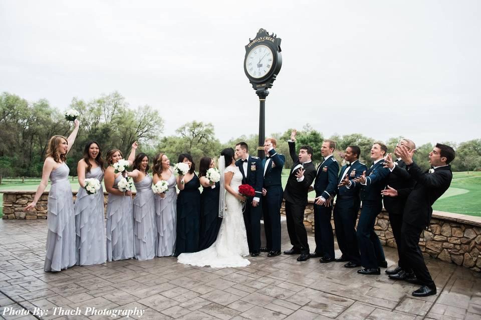 Wedding party under a clock