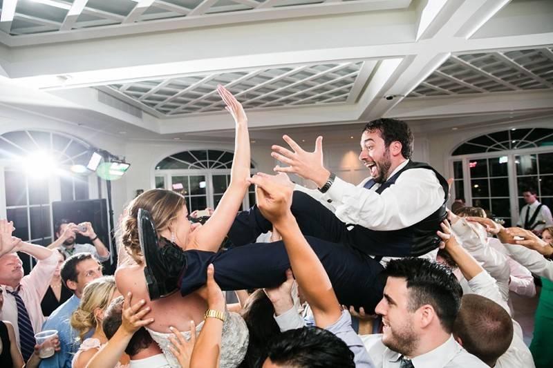Crowd-surfing newlyweds