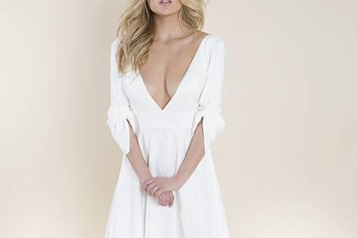 Sleeved dress with a deep v-neck