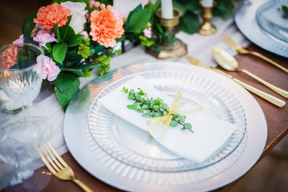 Reception table with plenty of greenery