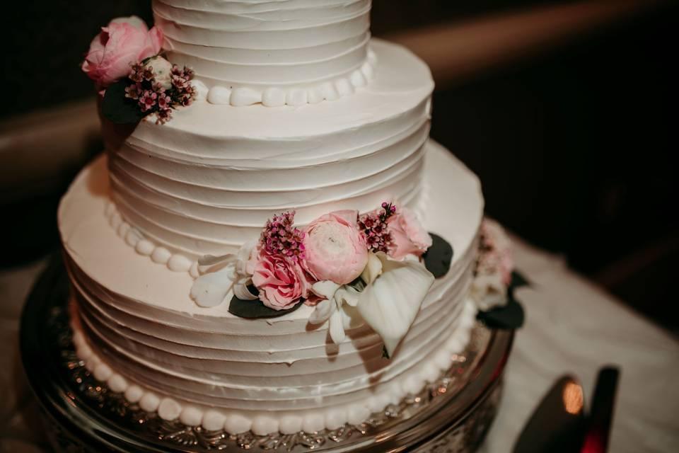 White cake, pink flowers
