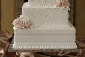 Four layered white wedding cake