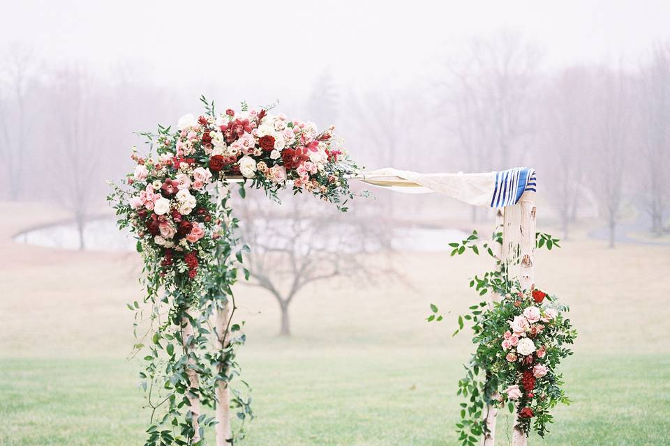 Red and pink floral Chuppah