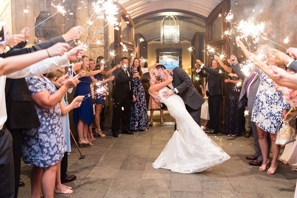 Newlyweds kissing with fireworks