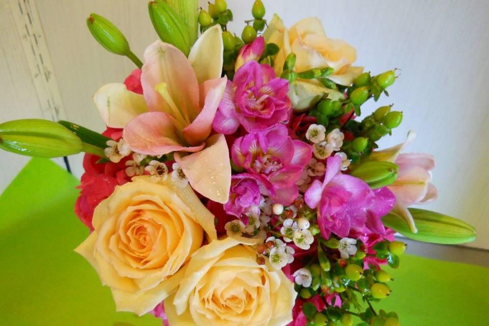 Bridal bouquet with roses, lilies, waxflower, hypericum berries, waxflower