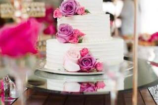 White cake with pink flowers