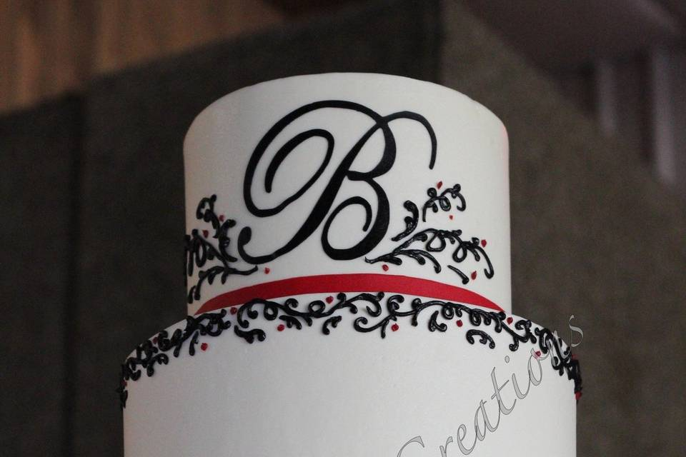 4-tier wedding cake with chocolate detailing