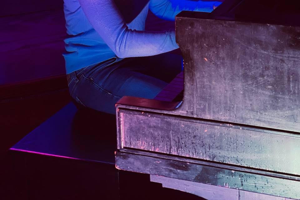 Ashley Hensel playing piano