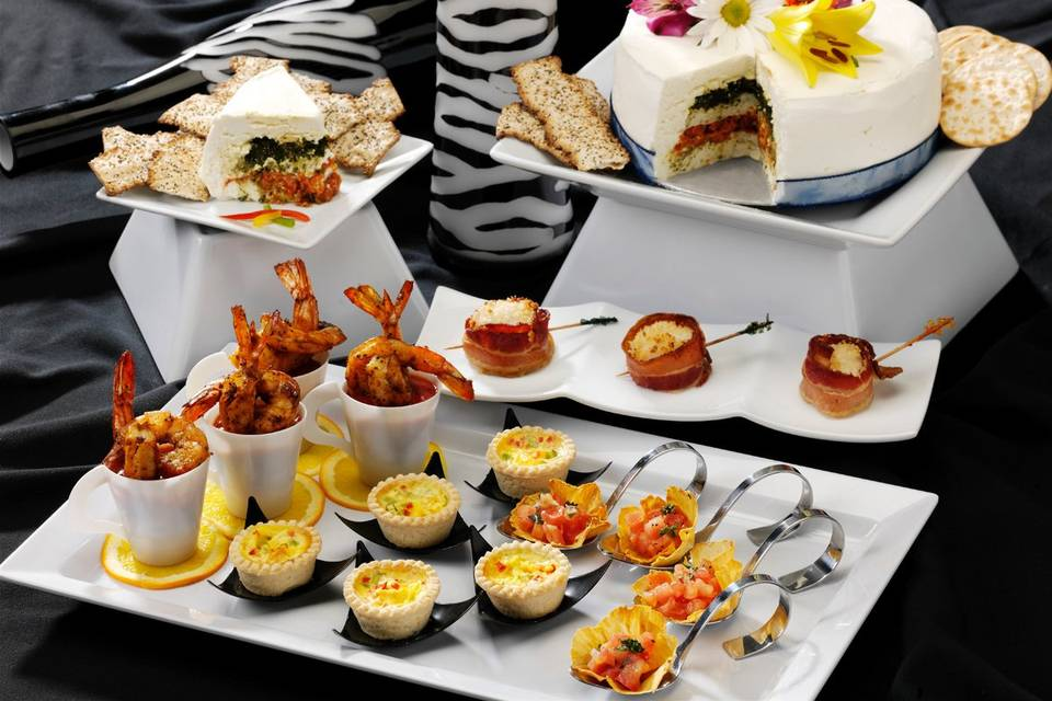 Classic Hors d'oeuvres including Miniature Quiche, Jumbo Shrimp Cocktail, Pineapple Flowers filled with Pico de Gallo, Five-Layer Cheese Torte and Bacon-Wrapped Diver Scallops