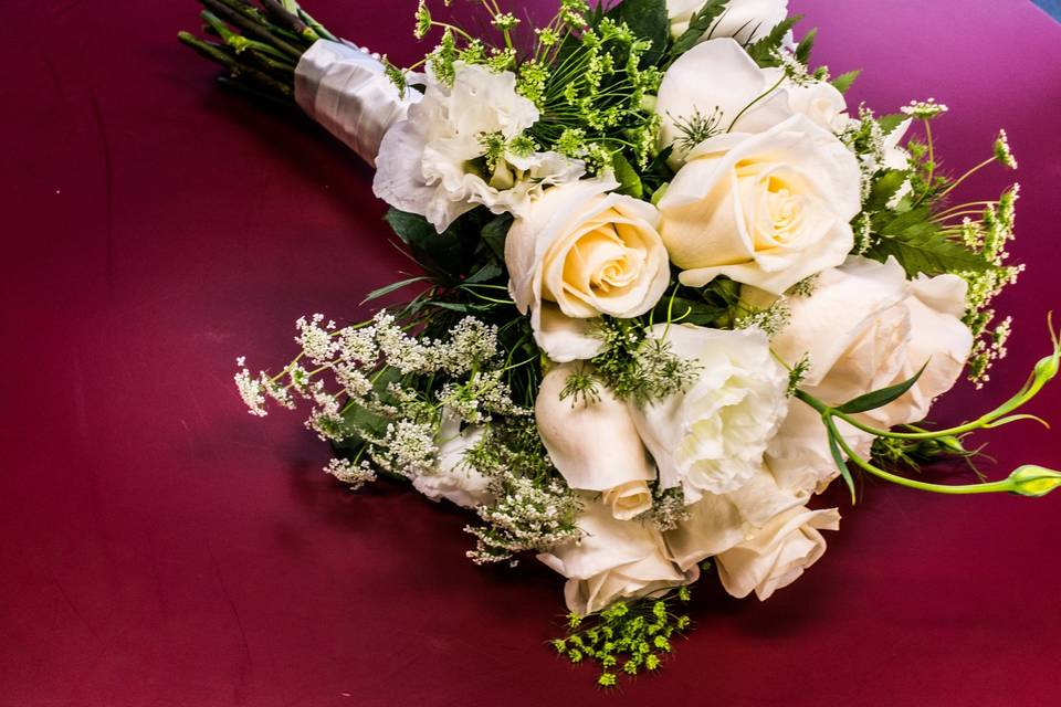 Hand-tied bridesmaid bouquet - roses, lisianthus, queen ann's lace
