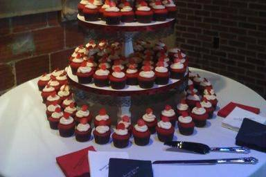 April 9th wedding cake, 150 red velvet cupcakes with cream cheese icing, 8 in red velvet top cake with buttercream.