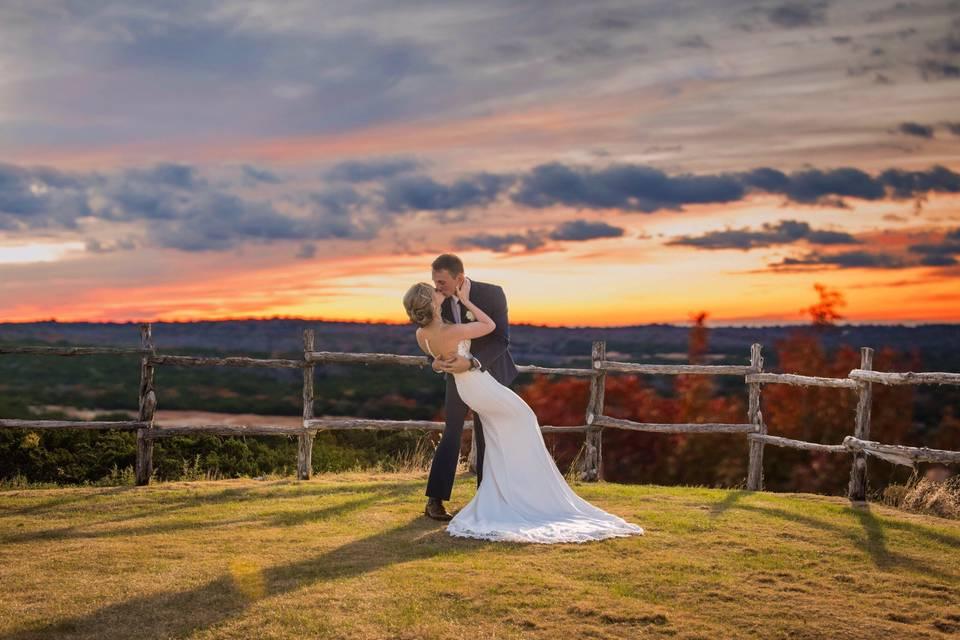 A kiss against a sun streaked sky