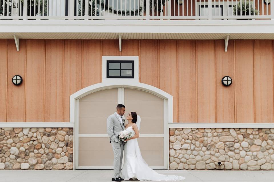 Newlyweds in front of their reception