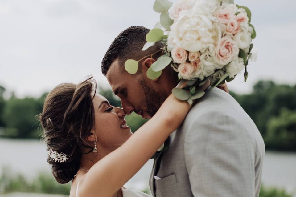 Couple embracing with bouquet