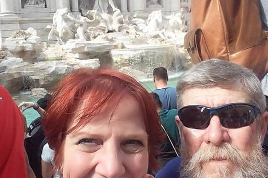 Rome and a visit to the Trevi Fountain has this happy couple smiling.