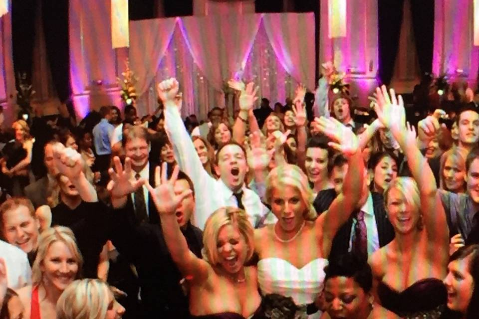 Bride partying with the crowd