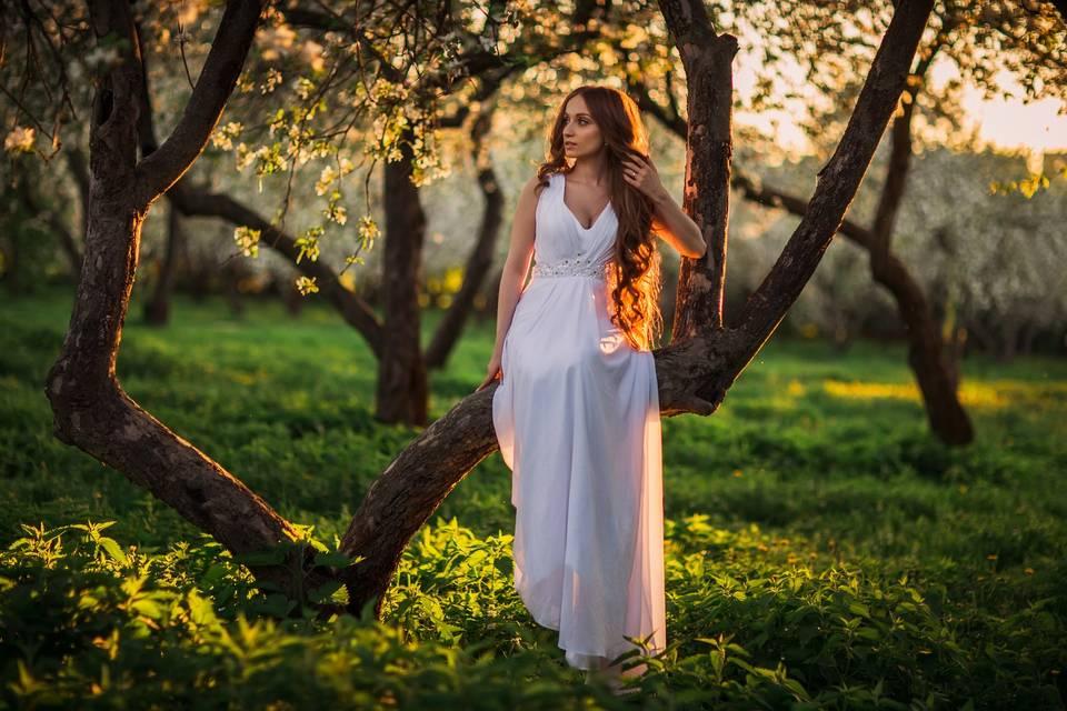 Bride beside a tree