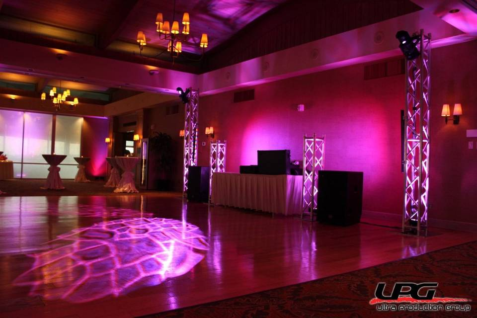 Our DJ setup is the best in the business. For weddings it elegant and can be tailored to your personal taste. This setup uses led lighting to theme the whole room together and truss towers add to a nice feel.