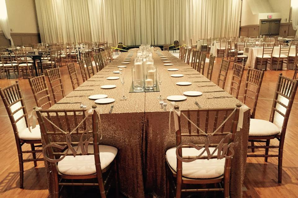 Long tables with brass chairs