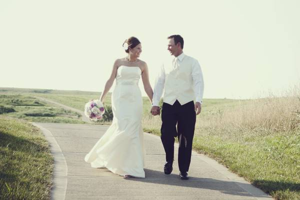 Newlyweds walking the course