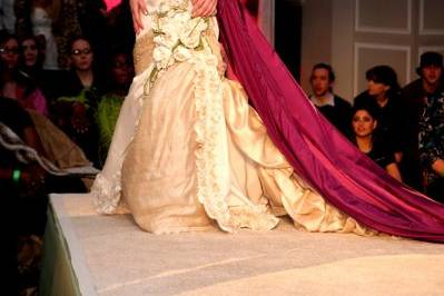 Peace silk and yards of ruffles. Hand rolled roses and leaves look as if they grew on the gown. Photo courtesy of www.balanceweddings.com On the runway at the Green Wedding Showcase.
