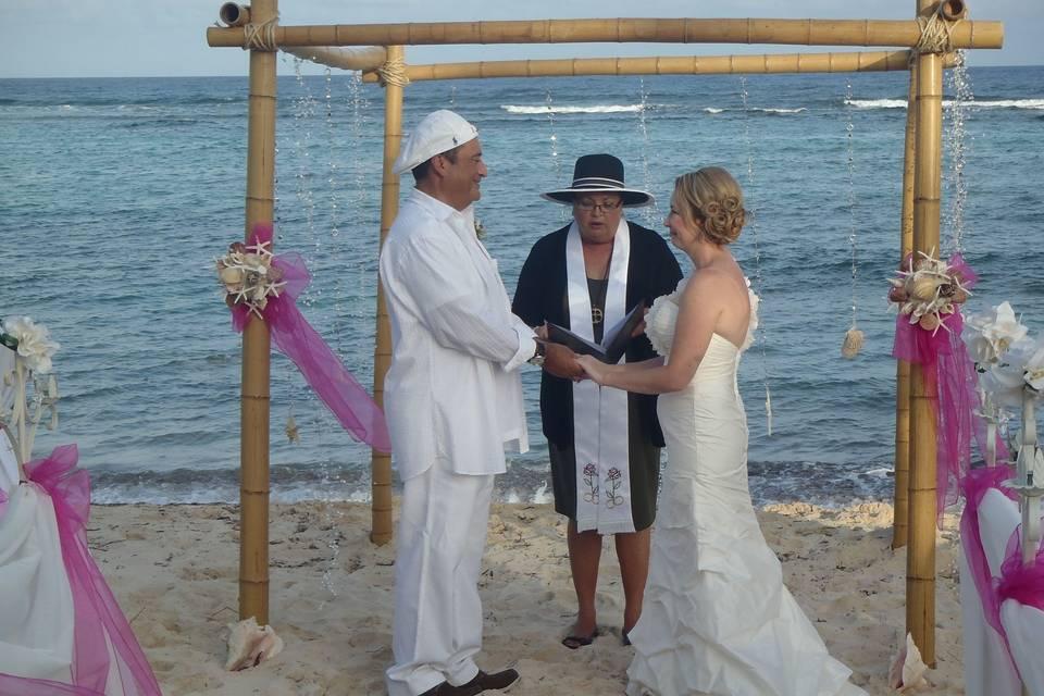 Joy officiates her 1000th wedding (in 5 years) at Turtle Nest Inn Beach, Grand Cayman