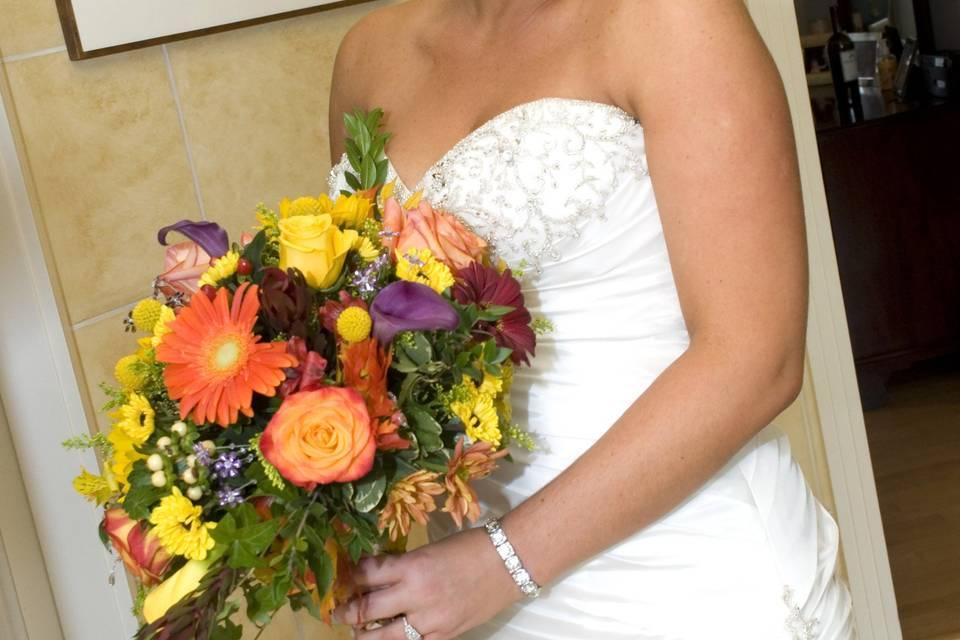 Bride holding spring bouquet