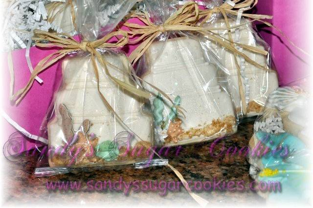Beach theme wedding cake sugar cookie favors, individually bagged and tied with matching theme ribbon.