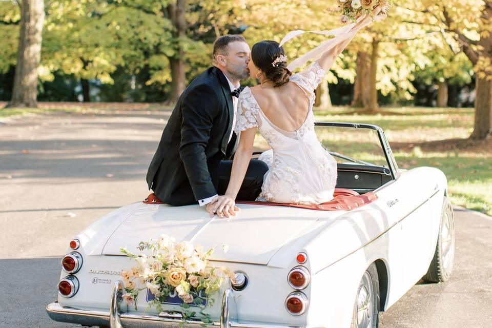Vintage getaway wedding car