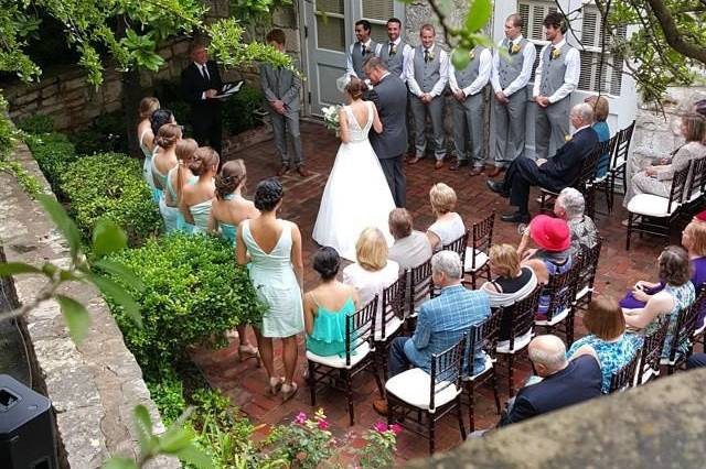 Outdoor ceremony in courtyard at chateau bellevue