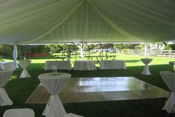 This is a 16'x16' dancefloor with cocktail tables positioned around it.