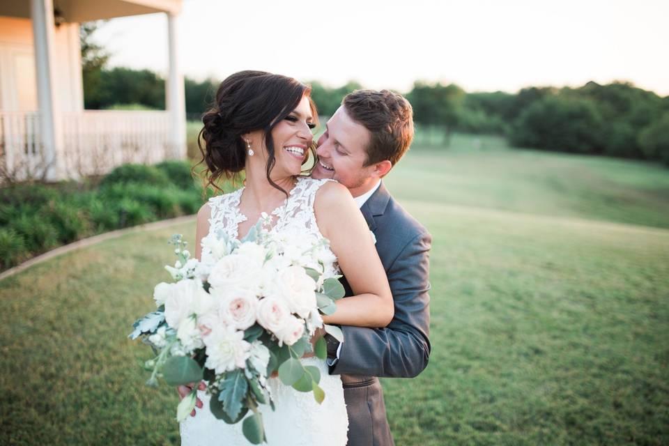Groom embracing his bride