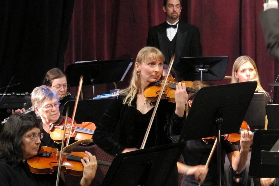 Noelle performing a solo with the Alpine Orchestra at the Steamplant in Salida, CO.