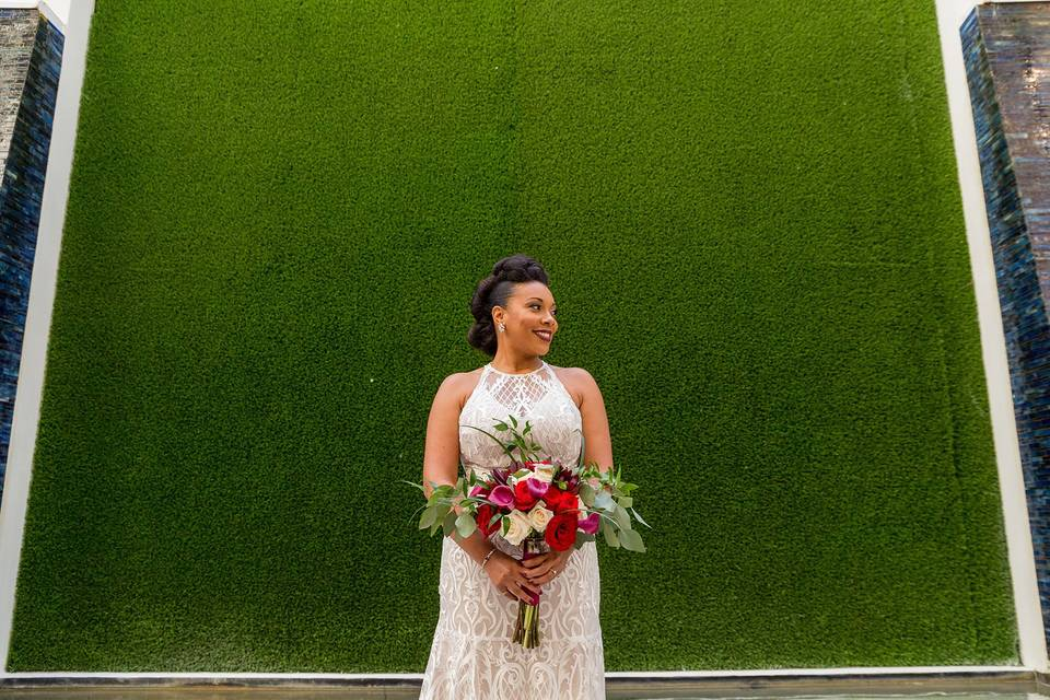 Bride and green wall backdrop