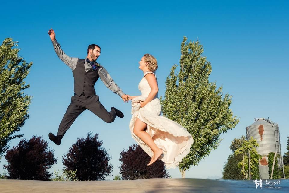 Jump shot of newlyweds | Lazzat Photography