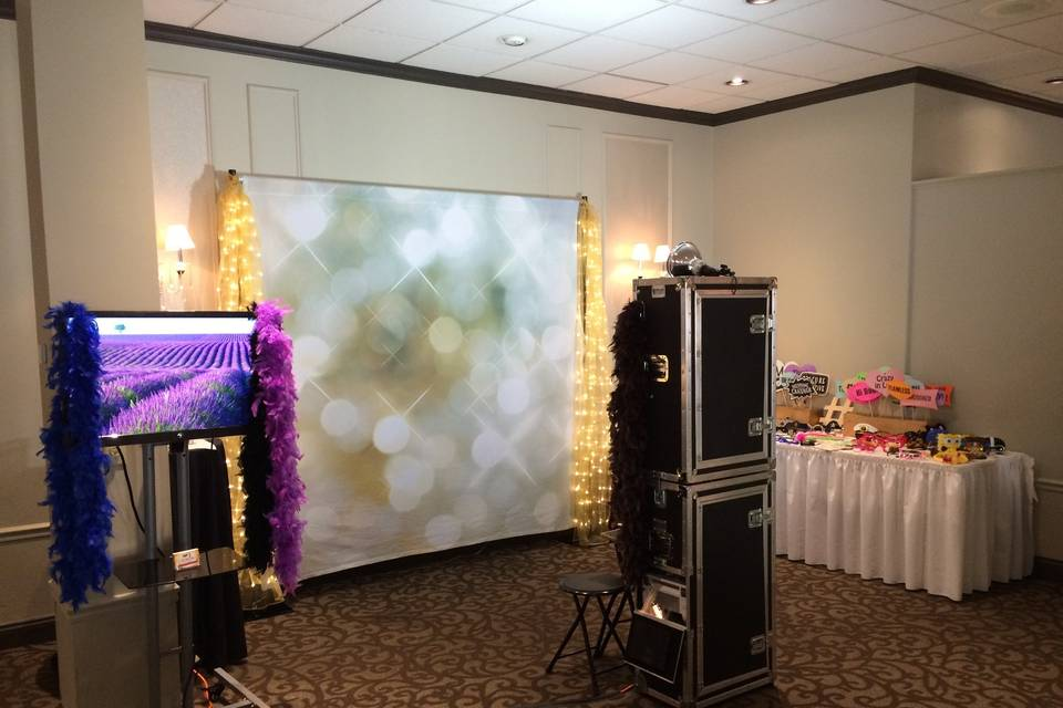 Typical setup: backdrop, 8ft table for all the fun props, monitor to stream all the pictures live as they are taken, and the photo booth. If we are compiling your keepsake wedding album, then we will use a tall round cocktail table.