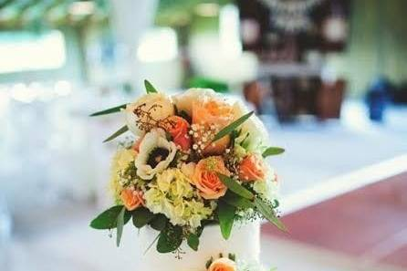 Buttercream raked cake with fresh flowers