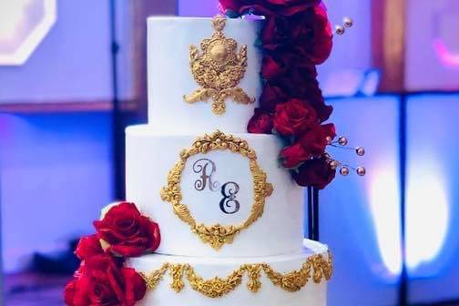 Red and gold ornate cake icing