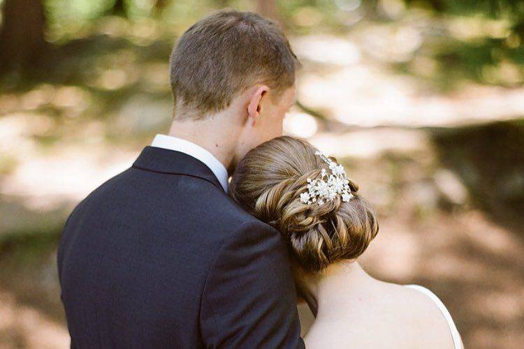 Groom and bride holding each other