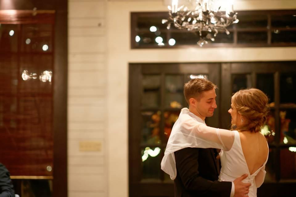 Couple dancing beneath a chandelier
