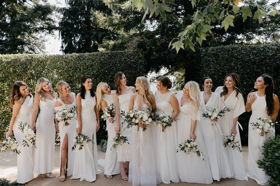 Candid image of bride with bridesmaids