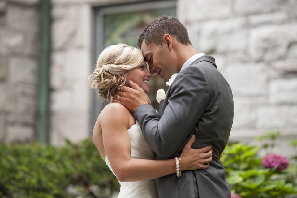 Newlyweds kissing outside