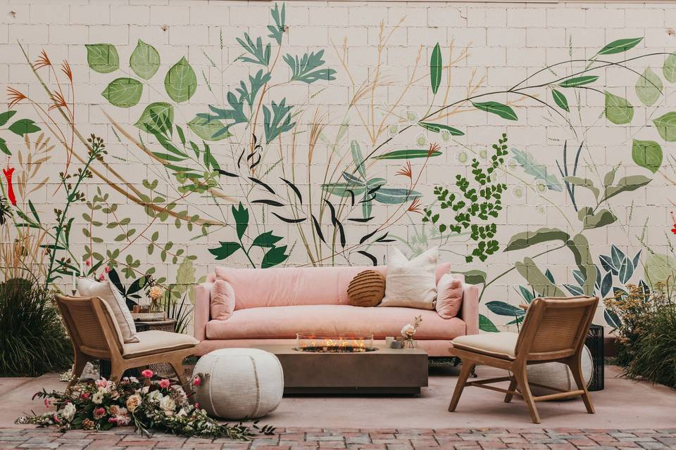 Styled lounge beside the mural