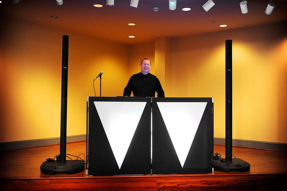 DJ set-up designed specifically for Weddings and Receptions. Dual Bose L1 Towers Speaker System with awesome sound and a sleek and professional look. Booth can be lit to match your room and decor.