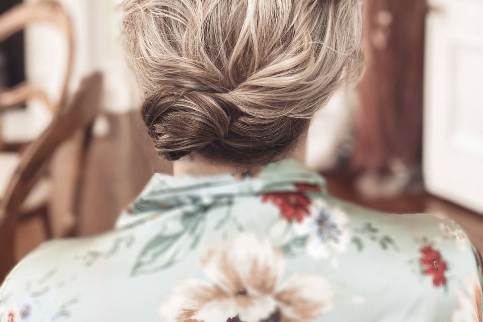 Tousled textured low side bun