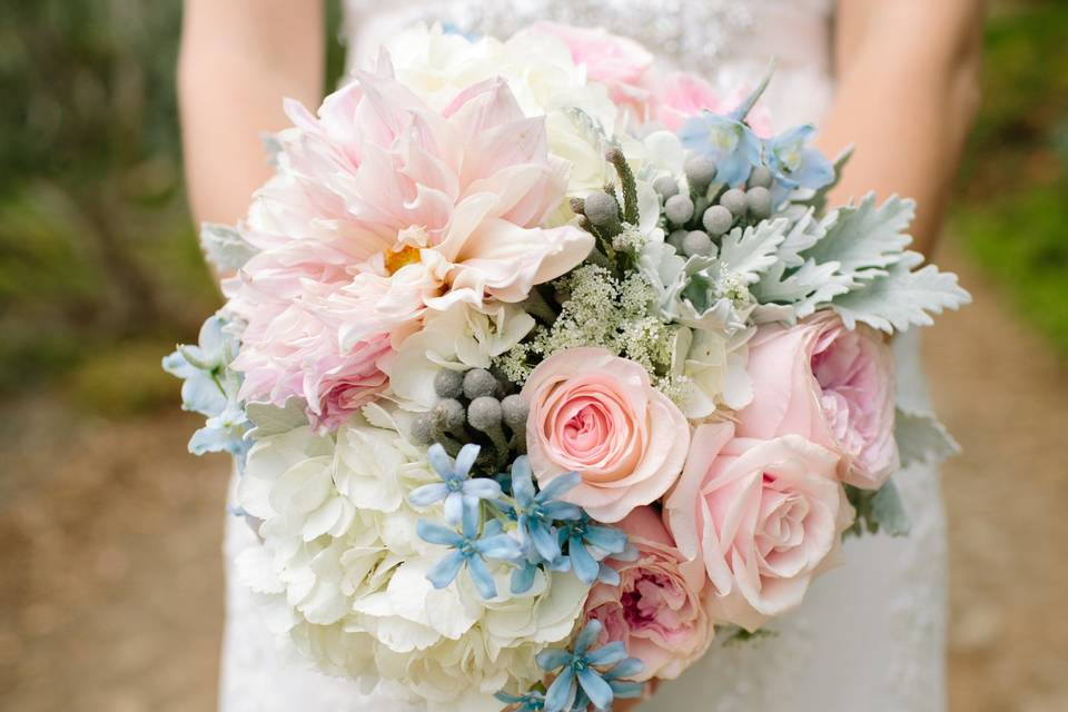 Pastel bridal bouquet with giant dahlias and garden roses.