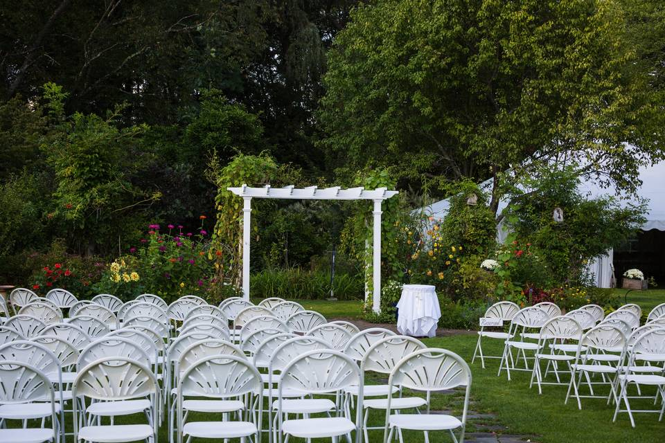 Ceremony chairs and arbor