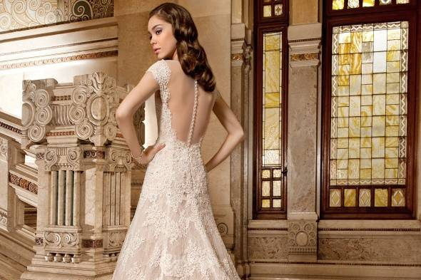 Beautiful lace gown by Demetrios in our store!