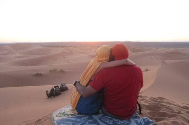 One of my Honeymoon couples enjoying a Morocco desert sunrise.